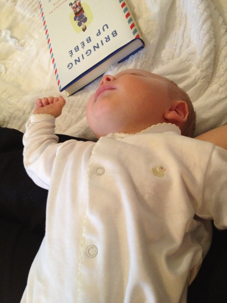 This Bébé is passed out and Momma is taking a break from her reading.
