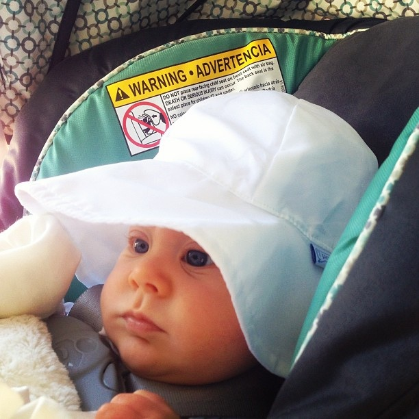 Griffin with his new sun hat - just taking in the sights and sounds of Seaside, FL